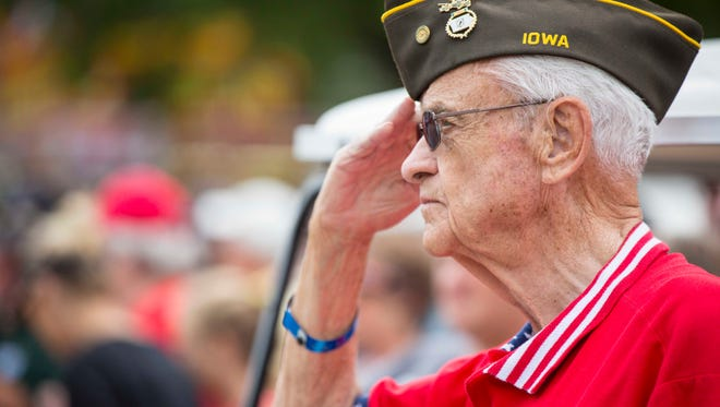 Former US Rep. Leonard Boswell salutes during the Veteran's Day parade at the Iowa State Fair Monday Aug 15, 2016.