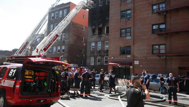 Yonkers Firefighters battle a 4 alarm fire at 28 Caryl Avenue in Yonkers on Aug. 15, 2016. Multiple families were displaced by the fire.