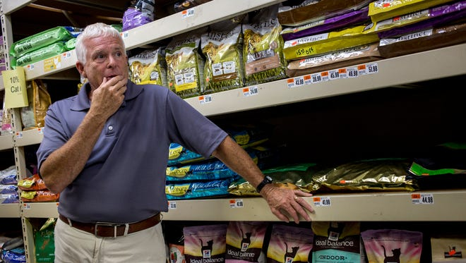 Owner Steve Britz pauses as he talks with a customer about the closing of his store Tuesday, August 16, 2016 at Pet Supplies Plus in Fort Gratiot.