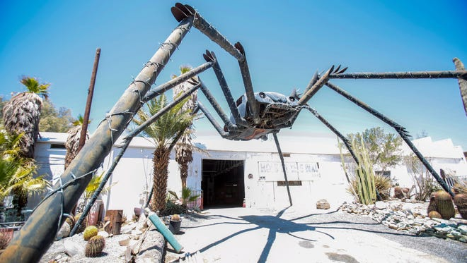 A 28 foot tall black widow spider made out of a Volkswagen Beetle, built by Robert Miner, guards the entrance to the Hole in the Wall auto repair shop in North Palm Springs. Miner ran his shop from the early 1970s till the 1990's and now the large shop and its surround land is home for Miner's daughter Erin Miner and her family. Photo taken on August 10, 2016.