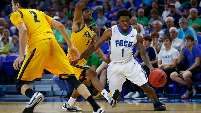 Florida Gulf Coast guard Reggie Reid (1) penetrates against Kennesaw State guard Yonel Brown (4) during the first half Tuesday, March 1, 2016 at Alico Arena in Fort Myers, Fla. The 4th seeded Florida Gulf Coast Eagles took on 5th seed Kennesaw State Owls in the first round of the 2016 Atlantic Sun Men's Basketball Tournament. FGCU won 74-64.