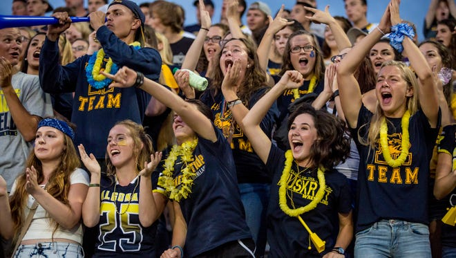 Algonac students cheer during a football game Thursday, August 25, 2016 at East China Stadium.