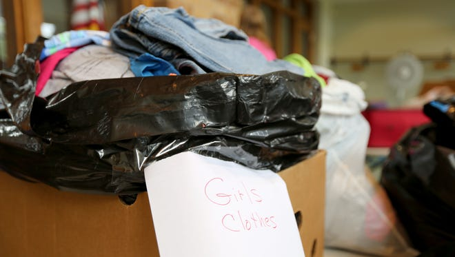 A box overflowing with girl's clothes awaits shipping to Louisiana from Grace UCC in Two Rivers.
