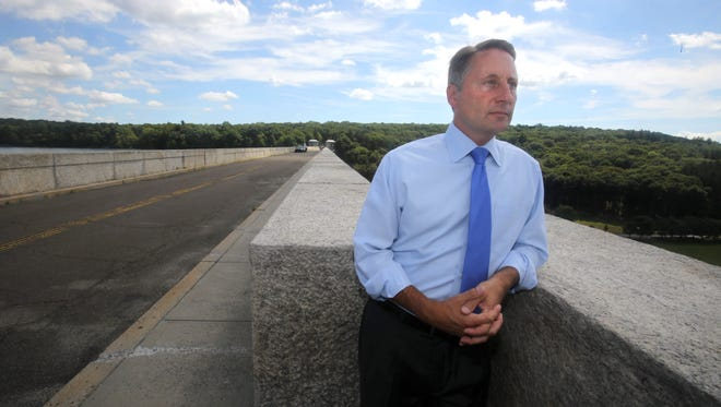 Westchester County Executive Rob Astorino stands on the roadway on top of the Kensico Dam in Valhalla Aug. 30, 2016. The road has been closed to vehicular traffic since the Sept. 11, 2001 attacks. In 2012 the road was reopened to pedestrian traffic.