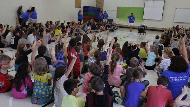 Merrill Elementary School Principal Sarah Poquette talks to the students on their first all school meeting. The Oshkosh Area School District held its first day of school for students Sept. 1, 2016.