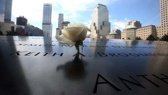 A flower rests in a letter on one of the names engraved at the reflecting pools at the 9/11 Memorial in lower Manhattan. With the 15-year anniversary of the Sept. 11 attacks approaching, the World Trade Center site is once again a bustling commercial hub in lower Manhattan, as well as a permanent reminder of the 9/11 attacks.