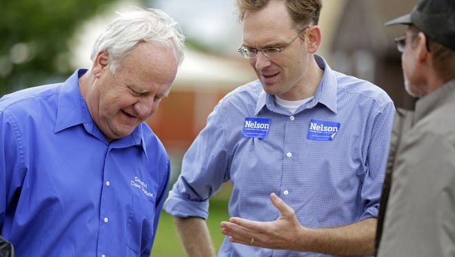 Tom Nelson (center), the Democratic candidate for the 8th Congressional District seat, talks with State Sen.Dave Hansen (D-Green Bay) during a stop at an Iron Workers skill event near Brillion.