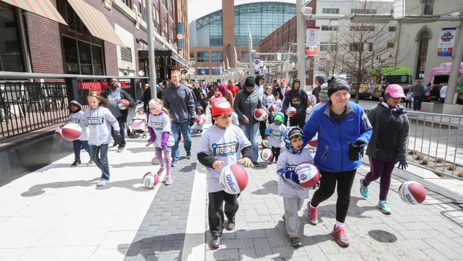 Families brave cold temps and high winds during the NCAA Final Four Bounce down Georgia Street in Indianapolis, Saturday April 2nd, 2016. The event was a tiny marathon for kids hosted by Freddy Fever and Indiana Fever players.