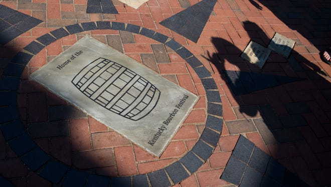 An attendee snaps a photograph of the center of the Bourbon Compass at the courthouse in downtown Bardstown, Ky on Wednesday. Sept. 14, 2016