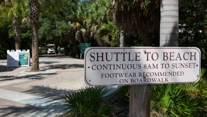 The Clam Pass Park offers a shuttle service at their beach access point in Naples, Florida. As more people come to Southwest Florida, debate is growing as to whether theyÕre being funneled into too few beach access points, with too limited and expensive parking.