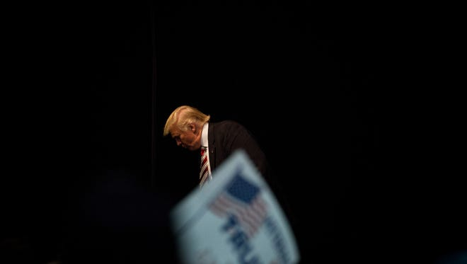 FILE-- Donald Trump, the Republican presidential nominee, exits the stage after speaking at a campaign event at the Seven Flags Event Center in Clive, Iowa, Sept. 13, 2016. Trump on Wednesday gave a small window into some of the results from his most recent physical examination in a taped appearance with the television celebrity Dr. Mehmet Oz. The quick run-through of results came after his aides had said he would, and then that he wouldn't, broach the topic on the show. (Damon Winter/The New York Times)