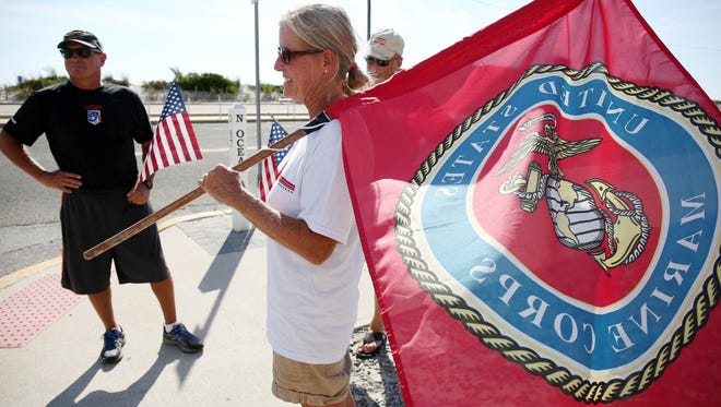 L_R...Tim Flynn, Betsy Flynn and Glenn Delmonico walked the route of the Seaside Park Semper Five Marine Corps charity run on Sunday.