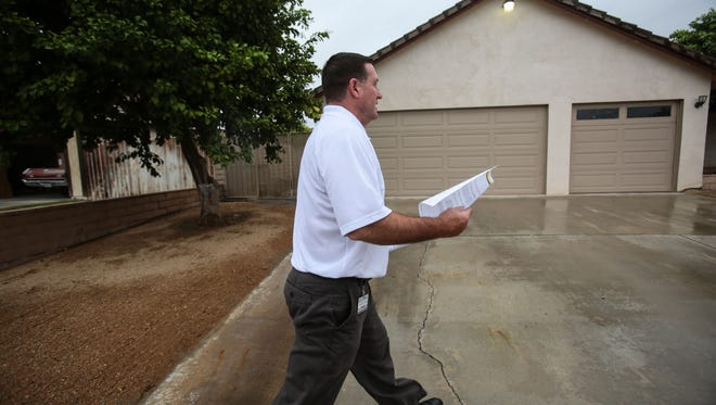 Jim Curtis the community services manager for the City of Indio passes out pamphlets to give Indio residents near the Empire Polo Club information on the upcoming Desert Trip concert weekends. Indio is doing outreach to address concerns about the concerts.