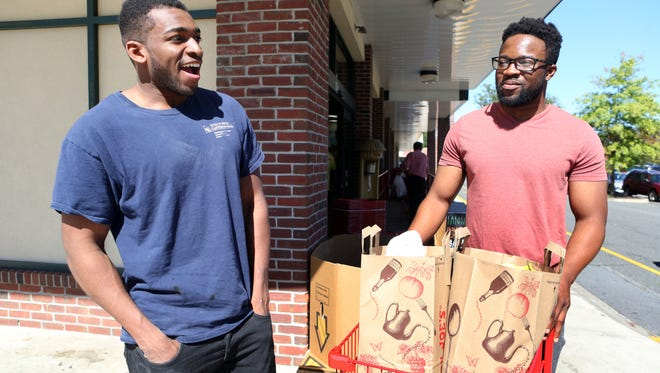 Valhalla residents A.J. Jebril, left, and Termidayo Aderibigbe say they are loyal shoppers at Trader Joe's in Hartsdale and look forward to an expansion.