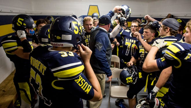 Algonac players get hyped up in the locker room during a football game Friday, September 23, 2016 at Algonac High School.