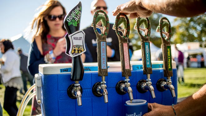 Beers from Oddside Ales and Short's Brewing Company are poured during the Port Huron Beer Festival Saturday, Sept. 24, 2016, at Kiefer Park in Port Huron.