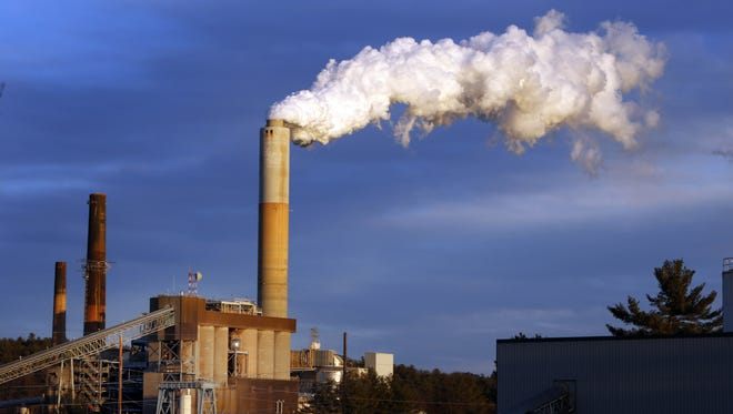 In this Jan. 20, 2015 file photo, a plume of steam billows from the coal-fired Merrimack Station in Bow, N.H. If the nation doesn't do more, the U.S. probably won't quite meet the dramatic heat-trapping gas reduction goal it promised in last year's Paris agreement to battle climate change, according to a new study.