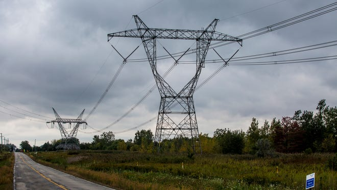 Power lines run along Puttygut Road near the Belle River Power Plant in East China Township. DTE announced it will be investing up to $1.5 billion in new facilities at the site by 2023.