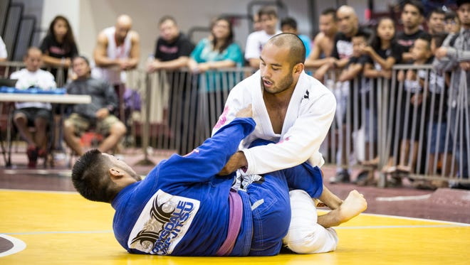 "In this file photo, Frank ""The Crank"" Camacho, in white gi, beats Drew Palomo for the gold medal in the purple belt division of the Copa de Marianas."