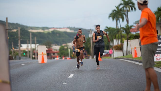 Runners sprint for the finish line at the in the 2nd Annual eCoast Run & Family Fair held at Coast360's Maite headquarters on Sept. 24.