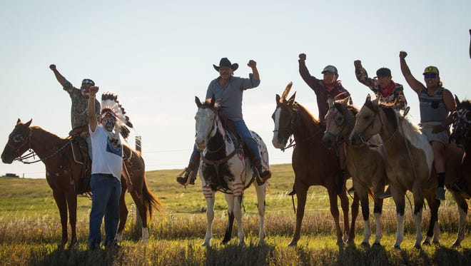 Crow Creek Sioux Tribe Chairman Brandon Sazue leads a group of horsemen near the sacred lands north of Oceti Sakowin Camp Thursday, Sept. 29, 2016, near the Dakota Access pipeline construction  less than two miles from the camp. Construction of the pipeline within 20 miles of the camp has been put on hold.