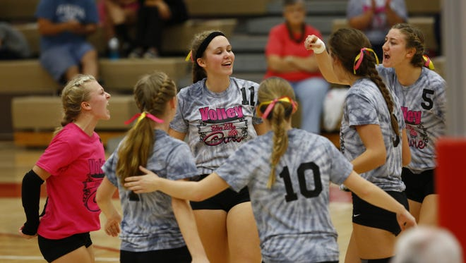 "Members of the Wausau West volleyball team celebrate a point during the ""Volley for the Cure"" match with Wausau East Thursday."