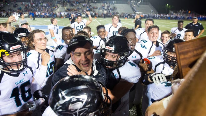 Gulf Coast Head Coach Pete Fominaya is doused with a jug of Gatorade while his players celebrate after defeating Barron Collier High School Friday, October 7, 2016 in Naples. Gulf Coast would win 15-11 clinching their first Catfish Bowl since 2007.
