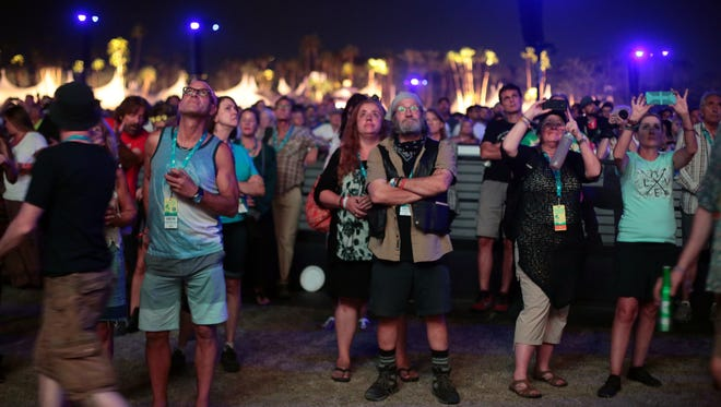 Fans watch Paul McCartney perform on the 2nd night of Desert Trip on Saturday, October 8, 2016 at the Empire Polo Club in Indio.