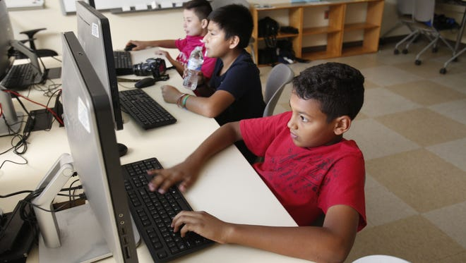 Students work on technology projects at Innovation Academy summer camp in Ossining in July 2016.