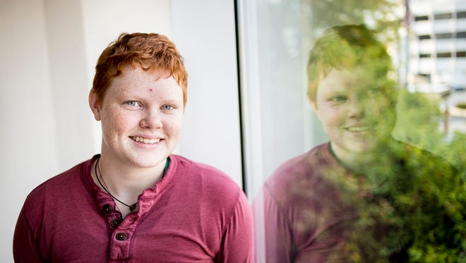 "Andrew Harwood, 22, struggled with years of anxiety and depression for much of his life until 2012, when he met a transgender person at Northern Michigan University. ""So, when I went there, I met my first transgender person,"" Harwood said. ""And I thought, 'That seems like a soul twin.' Then I started talking to them and their entire story is pretty much my story. I just hated my body my entire life. I didn't know what was wrong with it."" The interaction triggered Harwood's transition from identifying as female to male."