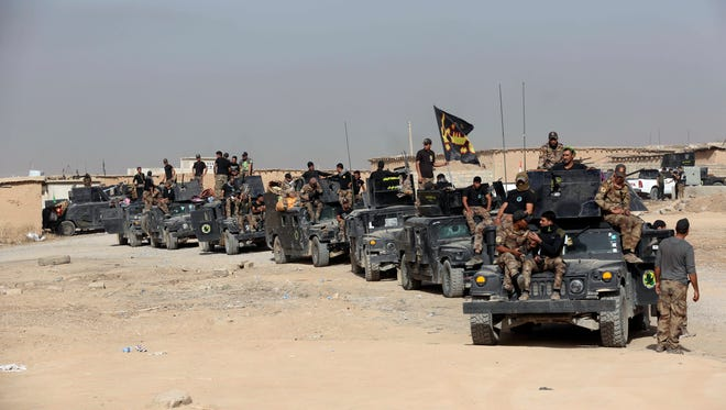 Iraq's elite counterterrorism forces gather ahead of an operation to re-take the Islamic State-held city of Mosul, Iraq.