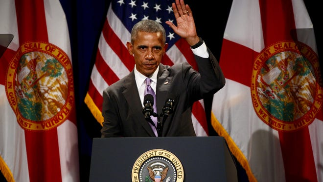 President Barack Obama waves as he leaves the stage after speaking about the Affordable Care Act at Miami Dade College on Thursday, Oct. 20, 2016, in Miami.