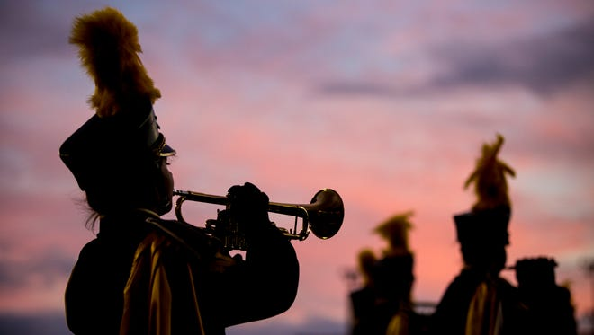 Members of the Port Huron Northern marching band perform during the Crosstown Showdown Friday, Oct. 21, 2016 at Memorial Stadium in Port Huron.
