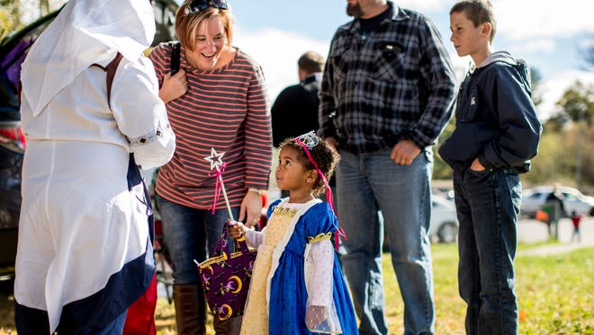 Cierra Richards, 3, is dressed as a Disney Princess while trick-or-treating along with her mother, Melissa Richards, father Jay Richards and brother Brenden Richards, 13, of St. Clair Township, during a trunk-or-treat Saturday, Oct. 22, 2016 at St. Clair Township Park.