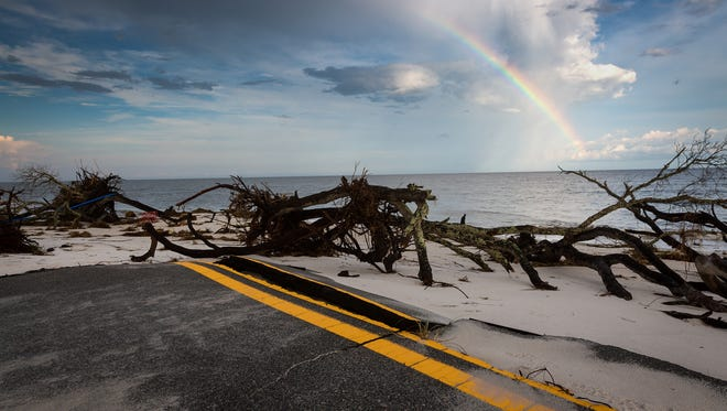The evening after Hurricane Hermine made landfall nearby, debris covers the end of Gulfshore Boulevard in Alligator Point, Fla. on Sept. 2, 2016. The stretch of road in the rural Florida Panhandle beach community is eroding into the Gulf of Mexico as infrastructure and homes are damaged and destroyed as the problem worsens.