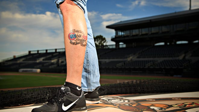 Noel Brown is photographed at Principal Park on Monday, Oct. 24, 2016. He already has a tattoo celebrating a Cubs World Series Championship.