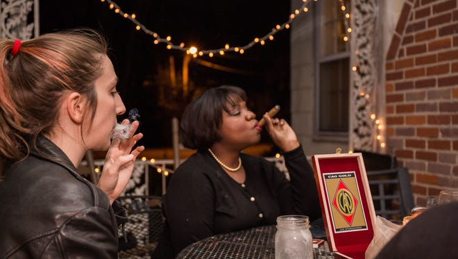 This was my first time smoking anything besides hookah. I tried to look cool. On the right is club member Sonya Frisby, the life of the party.