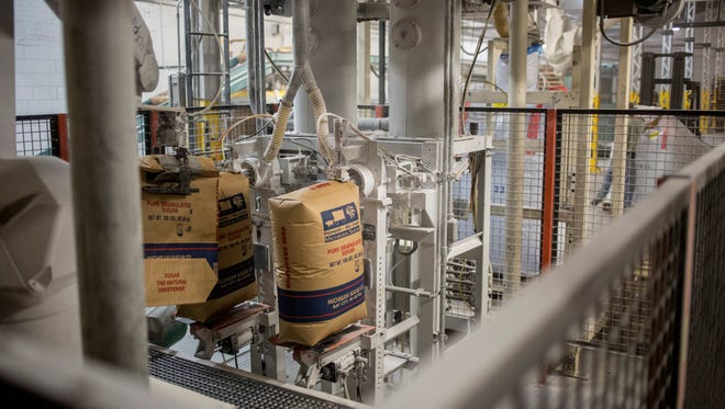 A machine fills bags with sugar in August 2016 at the Michigan Sugar plant in Croswell.