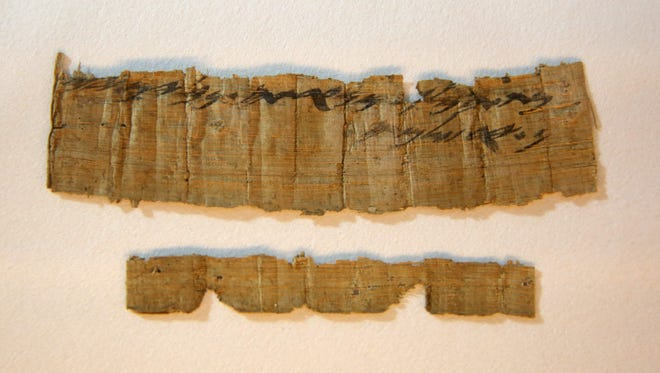 An ancient papyrus manuscript from the time of the First Temple is shown during a news conference in Jerusalem on October 26, 2016.