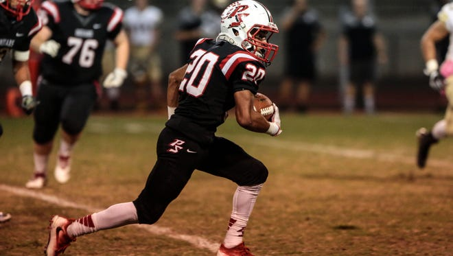 Palm Springs' Nick Reyes-Foster carries the ball for a touchdown against Xavier College Prep on Friday, October 28, 2016 in Palm Springs.