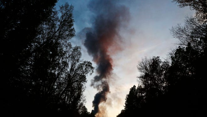 A plume of smoke rises from the site of an explosion on the Colonial Pipeline on Monday, Oct. 31, 2016, in Helena, Ala. Colonial Pipeline said in a statement that it has shut down its main pipeline in Alabama after the explosion in a rural part of the state outside Birmingham.