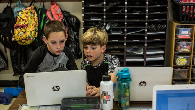 """Third-grade students Nicholas Delia and Wiley Roose, both 8, work together on a math lesson Wednesday, Nov. 2, 2016 at Capac Elementary School. Janet Buzzell is one of 10 teachers awarded a $20,000 """"Classrooms 4 the Future"""" from St. Clair County RESA."""