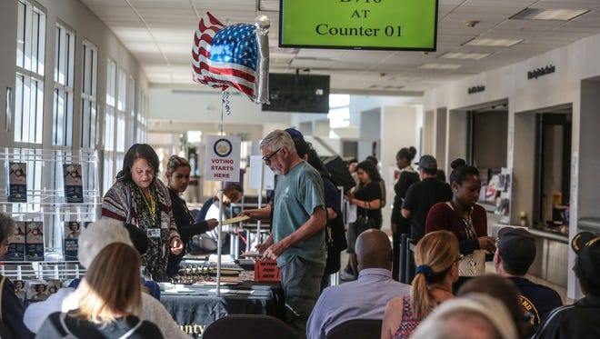 Voters at the County of Riverside Assessor County Clerk Recorder and Registrar of Voters office on November 1, 2016.