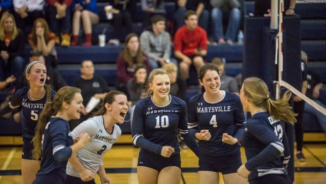 Marysville players celebrate during a Class B district semifinal volleyball game Thursday, Nov. 3, 2016 at Marysville High School.