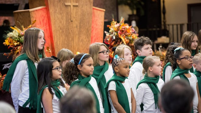 Singers perform in the 36th annual Thanks-Singing Festival in 2016 at Church of the Living God.