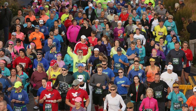 It was a sunny day for the Bass Pro Conservation Marathon Sunday, Nov. 6 2016. Excited runners start the race.
