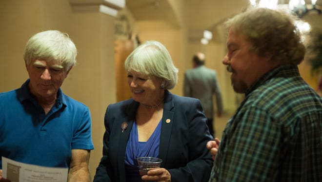Joanne Ferrary, and her husband Rich Ferrary, talk with Mark Steffen, in the hall outside the ballroom at Hotel Encanto Tuesday November 8, 2016. Ferrary was elected to serve in the State House District 37.
