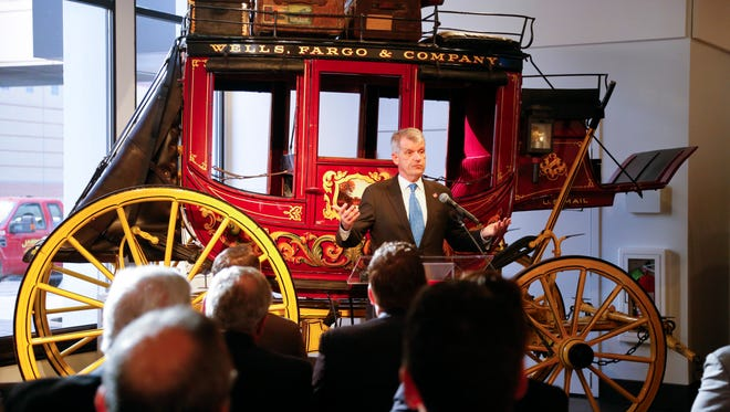Wells Fargo CEO Tim Sloan speaks at the opening of a new museum in the bank branch at 666 Walnut St., on Thursday, Nov. 10, 2016.