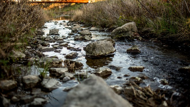 Water flows among rocks in Cuttle Creek in Marysville. The area was restored as part of a $2.75 million project funded by the Great Lakes Restoration Initiative.