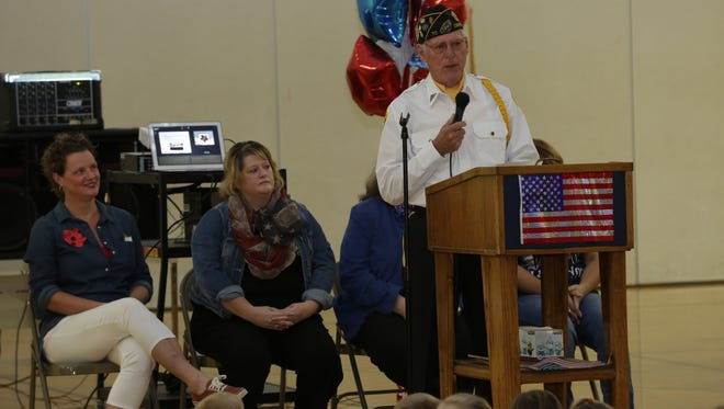 Veteran Norbert Gray of American Legion-Cook Fuller Post 370 talked about the background of Veterans Day. Carl Traeger Elementary School students and staff honored the veterans in 2016 by hosting a Veterans Day program at the school.